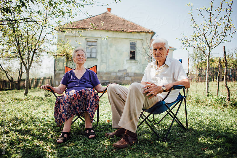 Senior couple enjoying a beautiful day outside by Boris Jovanovic for Stocksy United