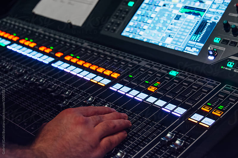 Sound engineer mixing sound on a console