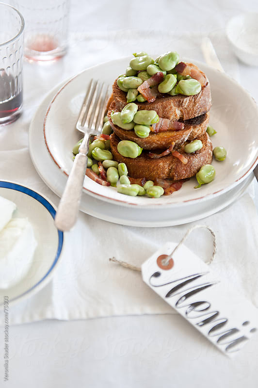 Fava bean crostini by Veronika Studer for Stocksy United