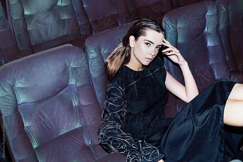 Female Fashion Model Sitting in the Cinema   by Katarina Radovic for Stocksy United