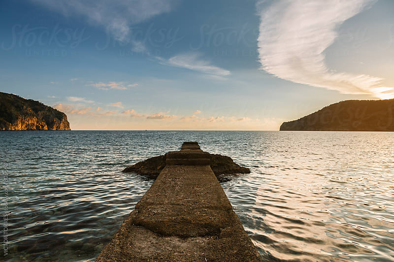 Rock Dock in a Heavenly Landscape by VICTOR TORRES for Stocksy United