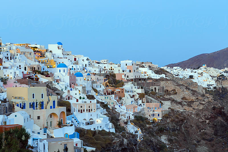 Dusk over Oia on the Greek island of Santorini. by Paul Phillips for Stocksy United