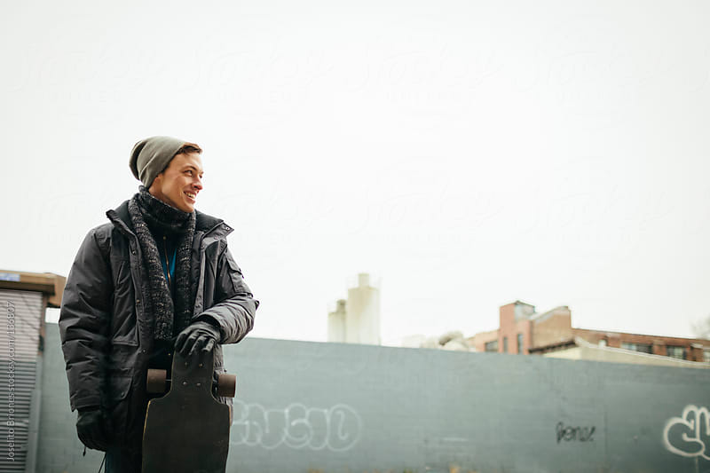 Winter Portrait of Young Man in Brooklyn by Joselito Briones for Stocksy United