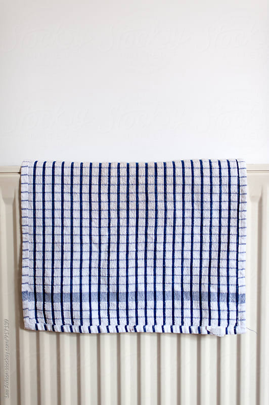 checkered tea towel on a radiator by Lee Avison for Stocksy United