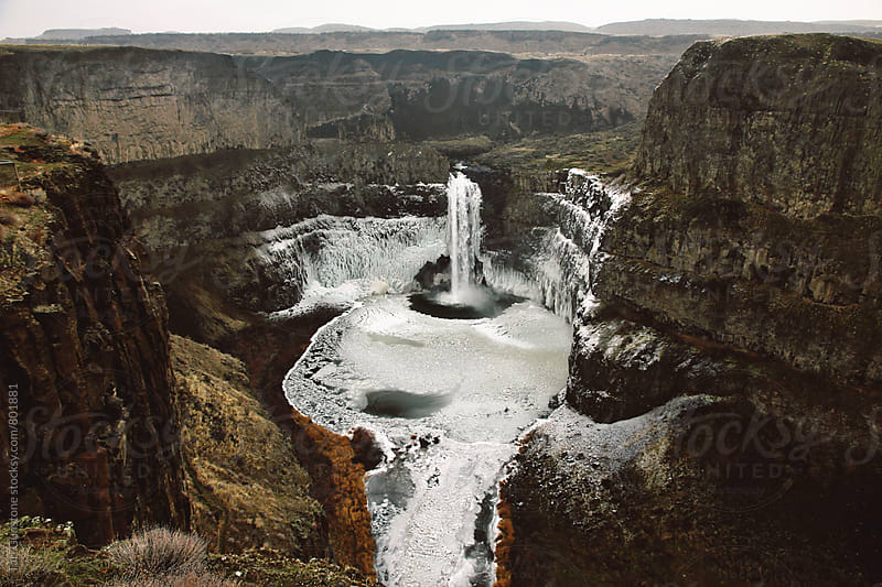 Palouse falls in winter by Tari Gunstone for Stocksy United