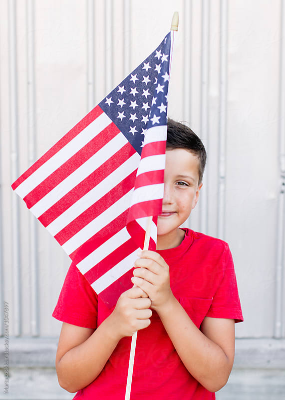 Boy Celebrating a Patriotic Holiday by Marta Locklear for Stocksy United