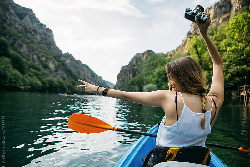 Girl Having Fun while kayaking  by Ani Dimi for Stocksy United