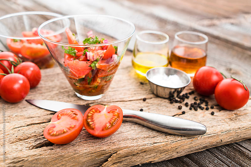 Making Fresh Summer Tomato Salad by suzanne clements for Stocksy United
