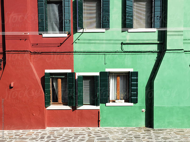 Red and green buildings in Burano, Venice by Kirstin Mckee for Stocksy United