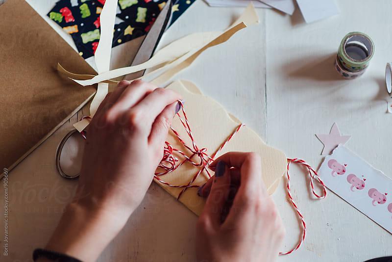 Designer creating handmade cards by Boris Jovanovic for Stocksy United