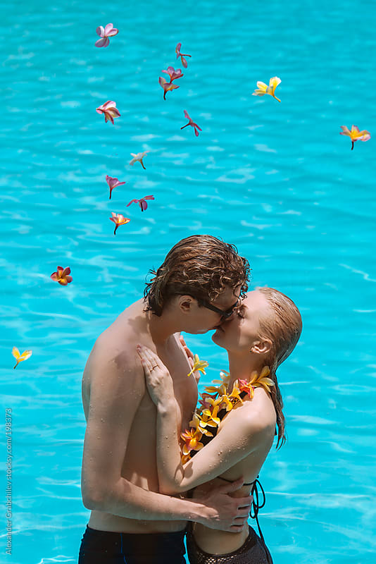 Couple In Love Kissing At Swimming Pool by Alexander Grabchilev for Stocksy United