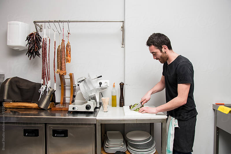 Man preparing some tapas by Bisual Studio for Stocksy United