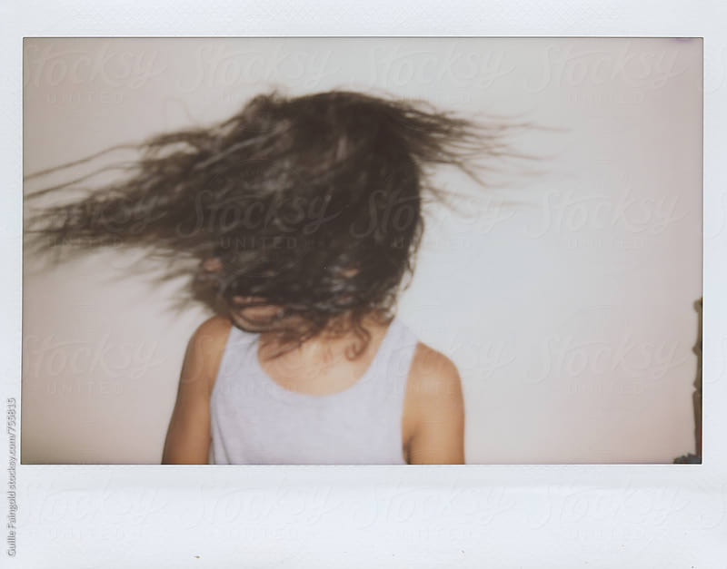 lovely little girl moving her hair by Guille Faingold for Stocksy United