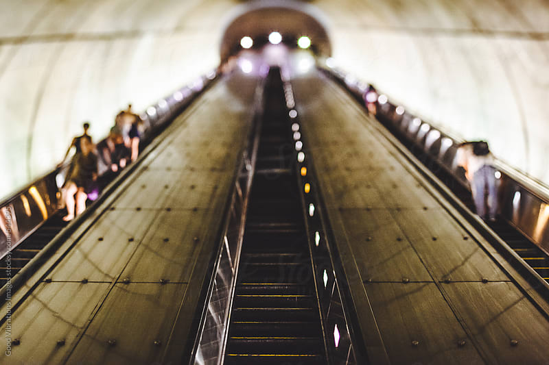 Escalator in a subway station by Good Vibrations Images for Stocksy United