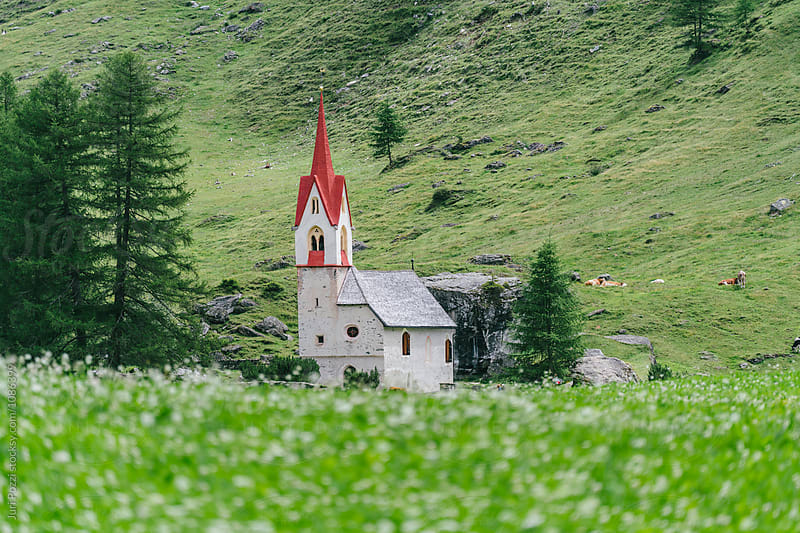 typical church in a beautiful landscape by Juri Pozzi for Stocksy United