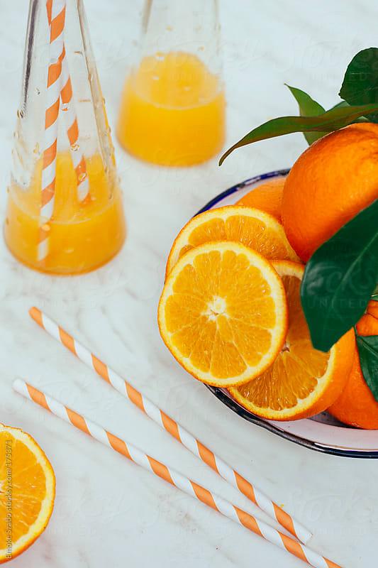Orange with leaves by Emoke Szabo for Stocksy United