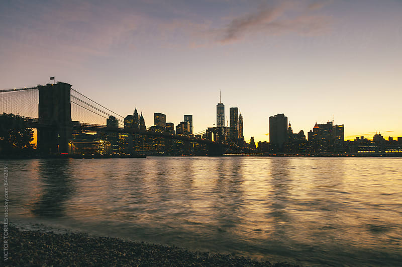 Brooklyn Bridge and East River, New York by Victor Torres for Stocksy United