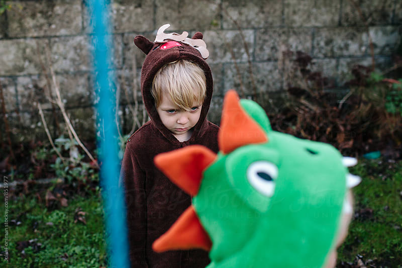 A girl in a reindeer costume is upset. by Julia Forsman for Stocksy United