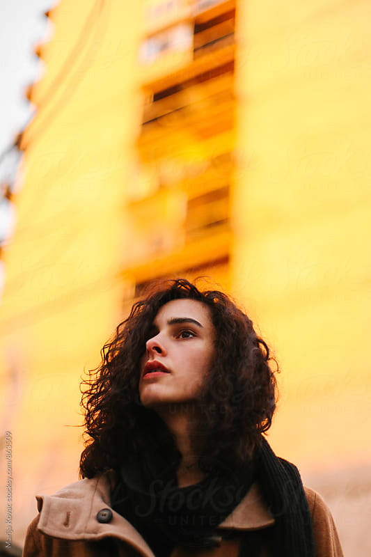 Curly woman during the sunset by Marija Kovac for Stocksy United