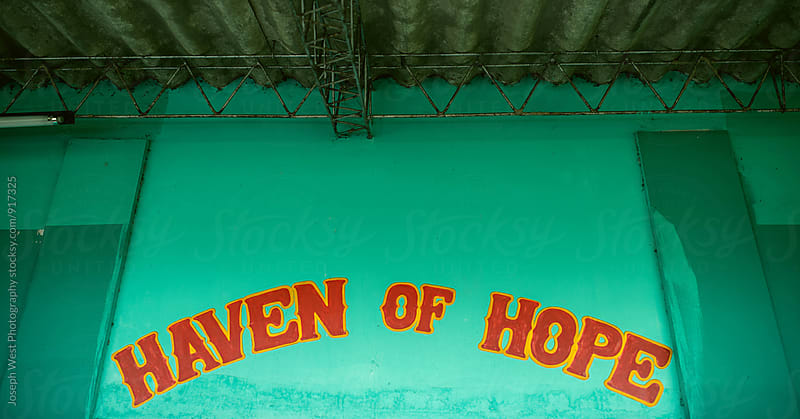 A painted sign reading 'Haven of Hope' by Joseph West Photography for Stocksy United
