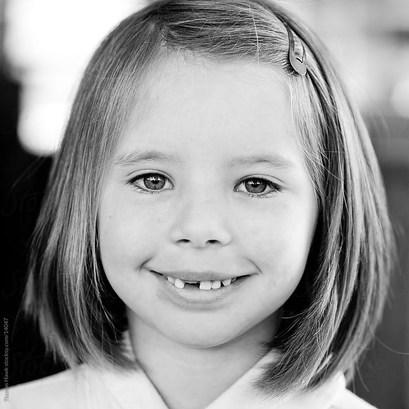 Girl missing tooth by Thomas Hawk for Stocksy United