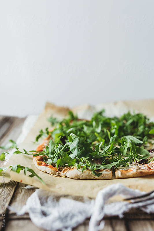 Homemade pizza by Tatjana Ristanic for Stocksy United