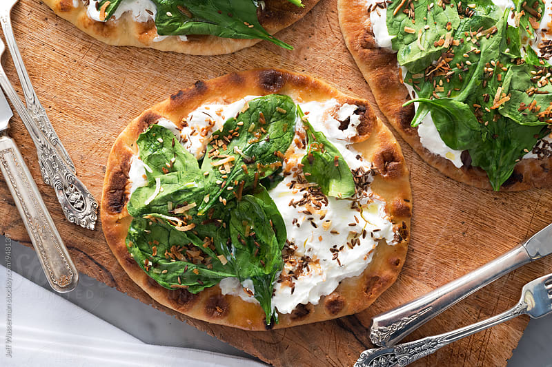 Spinach Yogurt Flatbread Naan Pizza by Jeff Wasserman for Stocksy United