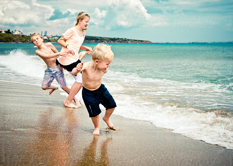 Kids Playing at the Beach by Stephen Morris for Stocksy United