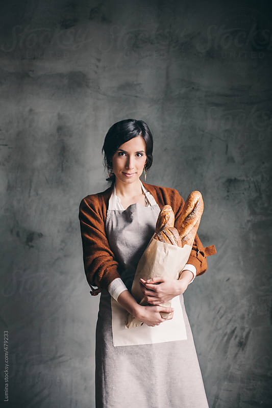Portrait of a Woman Selling Bread by Lumina for Stocksy United