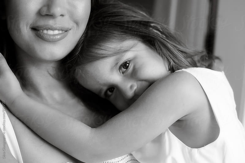 Daughter Hugging Mother And Smiling by Dina Giangregorio for Stocksy United