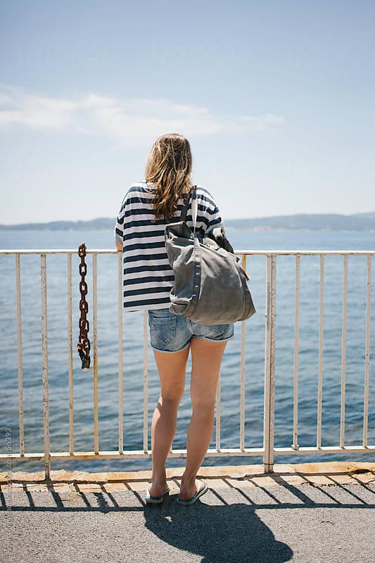 Girl looking over the sea in france. by Koen Meershoek for Stocksy United
