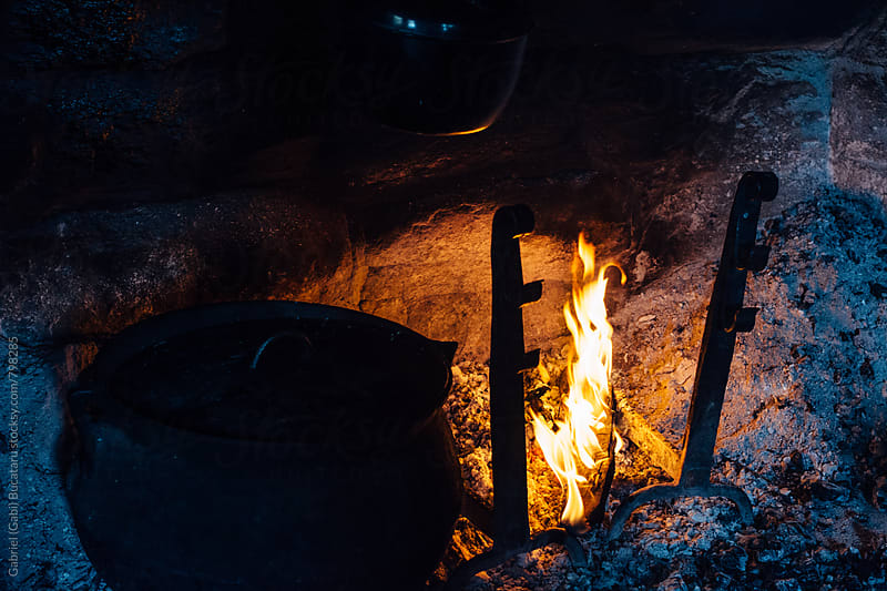 Old-fashioned cooking in a fireplace by Gabriel (Gabi) Bucataru for Stocksy United