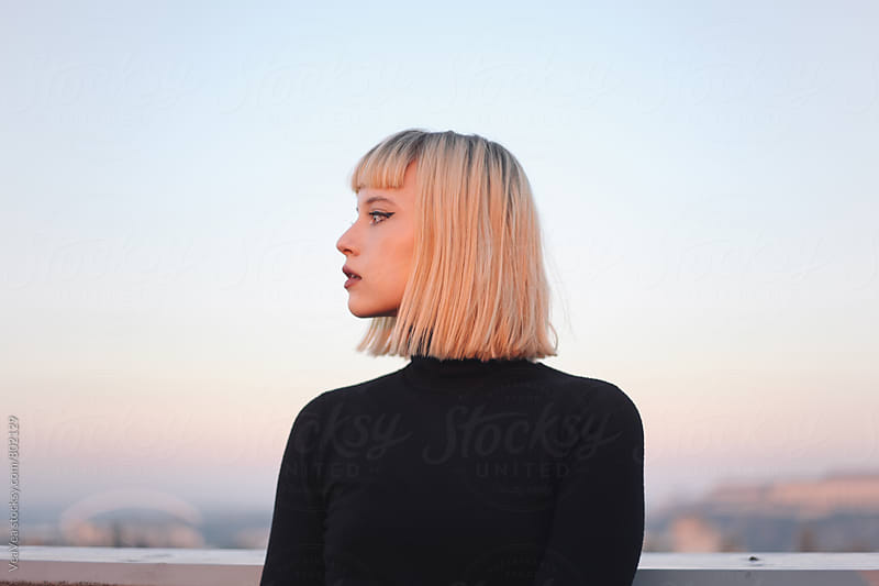 Portrait of a beautiful young woman duirng sunset  by VeaVea for Stocksy United