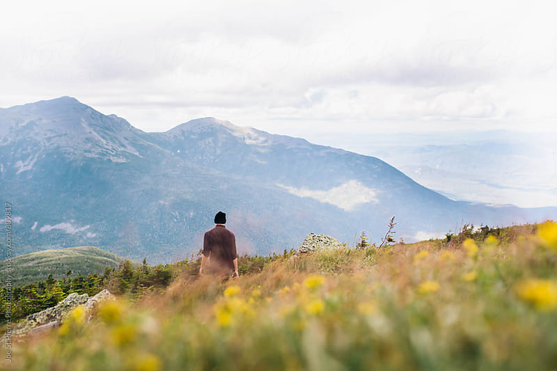 Young man walking on a mountain by Joe St.Pierre Photography for Stocksy United