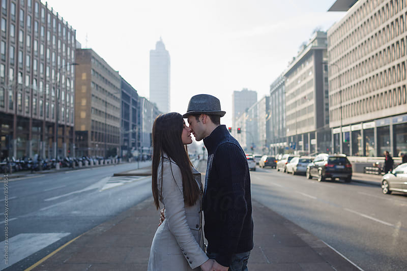 Intimate moment of a young couple in love in an urban context by michela ravasio for Stocksy United