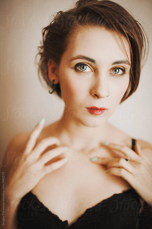 Portrait of a young beautiful girl with short hair by Sergey Filimonov for Stocksy United