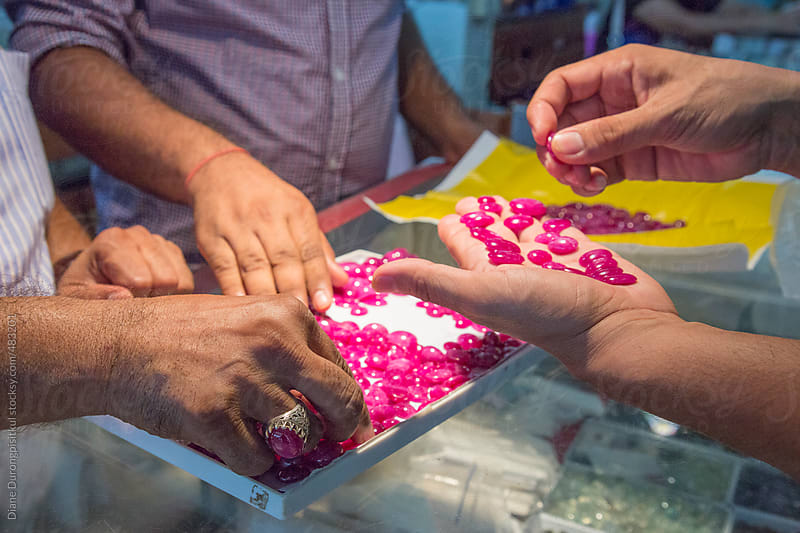 Hand picking Rubies by Diane Durongpisitkul for Stocksy United