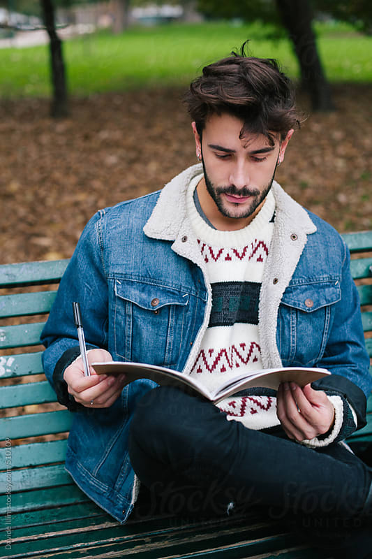Young man studying at the park by Davide Illini for Stocksy United