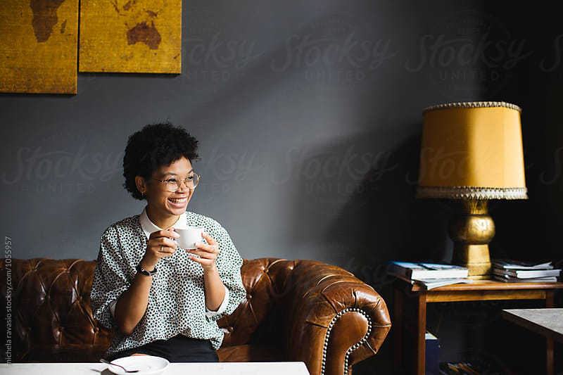 Smling girl drinking a cappuccino by michela ravasio for Stocksy United