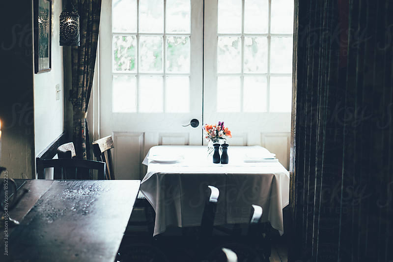 Empty dining room in a country inn by James Jackson for Stocksy United
