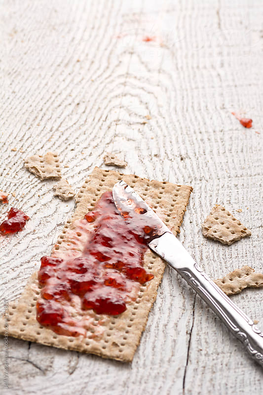 Whole Wheat Jewish Matzah at Passover and Strawberry Preserves by Jeff Wasserman for Stocksy United
