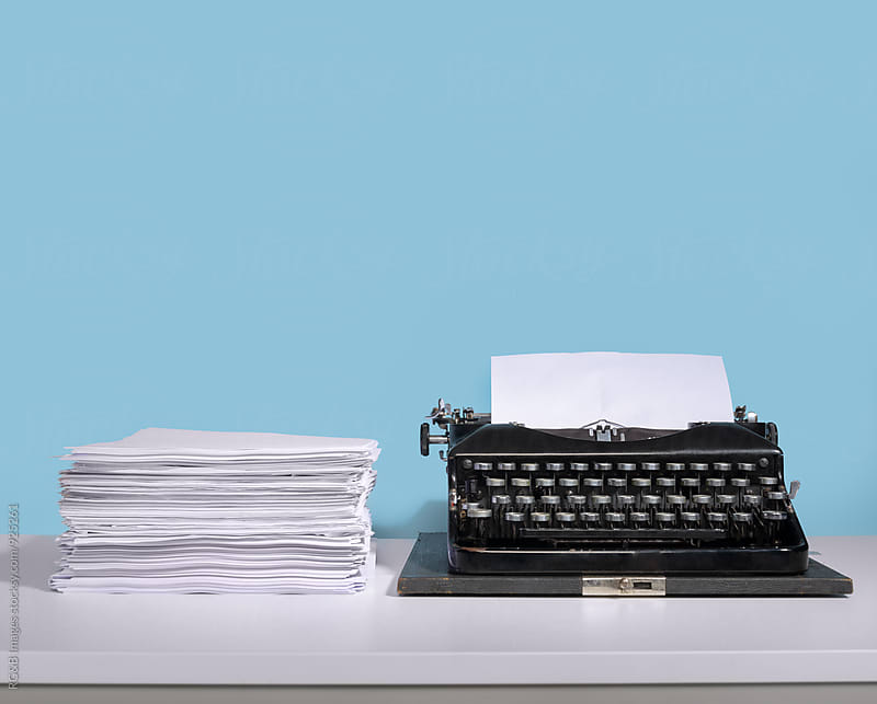 Vintage typewriter and paper stack by RG&B Images for Stocksy United