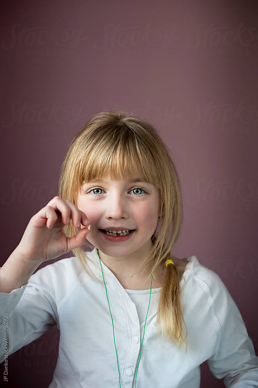 Little Girl With Loose Tooth by JP Danko for Stocksy United