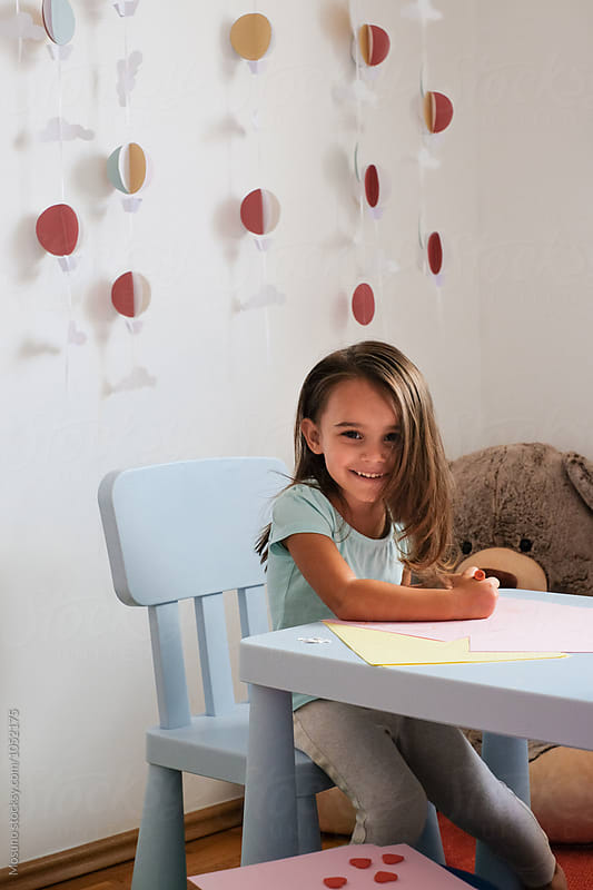Little Girl Drawing in her Playroom by Mosuno for Stocksy United
