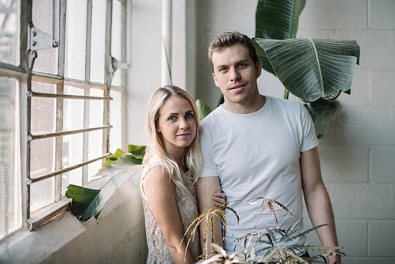 Young stylish couple in botanical industrial loft by Daring Wanderer for Stocksy United