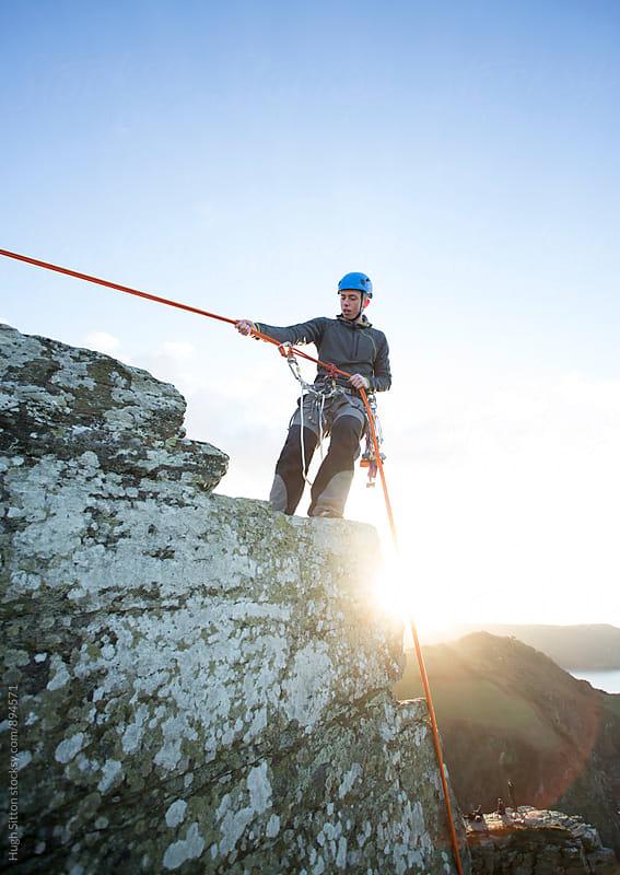 Teenage boy, rock climbing. by Hugh Sitton for Stocksy United