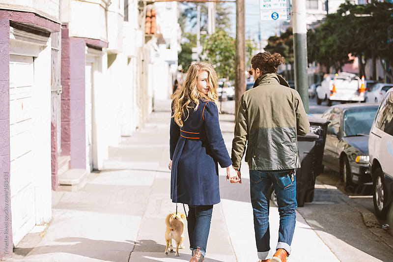 Couple walking in city by Trinette Reed for Stocksy United