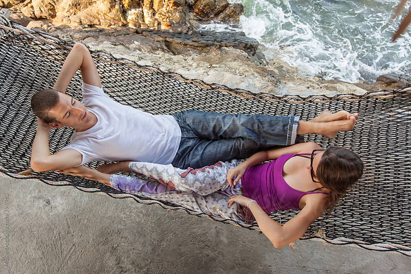 Young Couple in a Hammock by Mosuno for Stocksy United