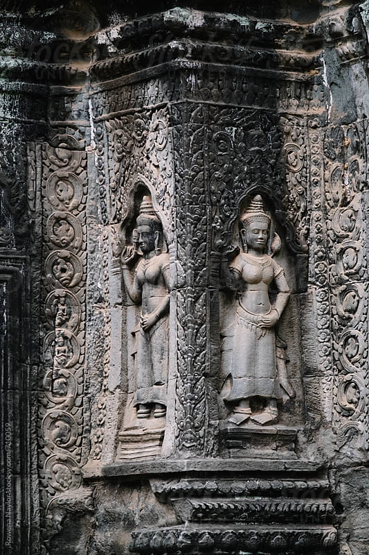 Ancient carvings on Ta Prohm Temple, Siem Reap, Cambodia by Rowena Naylor for Stocksy United