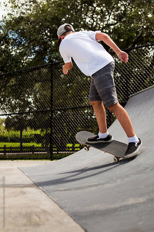 Boy RIding Skateboard on Ramp by Stephen Morris for Stocksy United